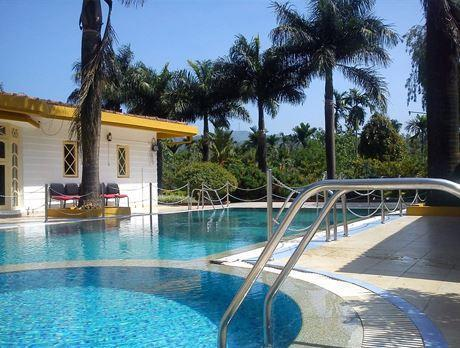 Cynosure resort hotel at coorg for Resorts in kodaikanal with swimming pool