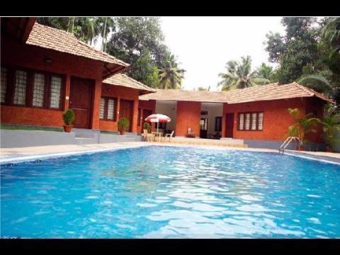 Deshandan cliff beach resort hotel at varkala for Kodaikanal cottage with swimming pool